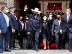 Peru's President-elect Pedro Castillo and his wife Lilia Paredes, wave as they leave the Foreign Ministry to go to Congress for his swearing-in ceremony on his Inauguration Day in Lima, Peru, Wednesday, July 28, 2021. (AP Photo/Guadalupe Pardo)