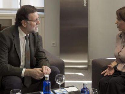 Rajoy y Mitzy Capriles, este viernes en la sede del PP.