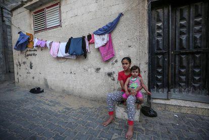 Niños palestinos en las calles de un campo de refugiados en Gaza