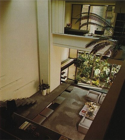 Aerial view of the living room.  To get to the guest area, you had to cross a walkway without a railing.  Also pictured is the tropical garden with palm trees that the house had before Halston replaced it with a bamboo grove.