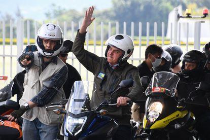 President Jair Bolsonaro greets his supporters on Sunday in Brasilia.