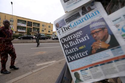 FILE PHOTO: A man looks at newspapers at a newsstand in Abuja, Nigeria June 5, 2021. REUTERS/Afolabi Sotunde/File Photo