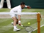Tennis - Wimbledon - All England Lawn Tennis and Croquet Club, London, Britain - July 7, 2021  Serbia's Novak Djokovic in action during his quarter final match against Hungary's Marton Fucsovics REUTERS/Paul Childs