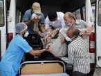 Healthcare workers and relatives carry Shashikantbhai Parekh, a patient with breathing problem, out from an ambulance for treatment at a COVID-19 hospital, amidst the spread of the coronavirus disease (COVID-19) in Ahmedabad, India, April 28, 2021. REUTERS/Amit Dave