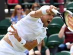 Wimbledon (United Kingdom), 05/07/2021.- Roberto Bautista Agut of Spain in action during his round of 16 match against Denis Shapovalov of Canada at the Wimbledon Championships, Wimbledon, Britain 05 July 2021. (Tenis, España, Reino Unido) EFE/EPA/FACUNDO ARRIZABALAGA EDITORIAL USE ONLY