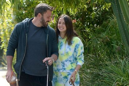 Ben Affleck and Ana de Armas are all smiles as they walk their dogs in Los Angeles. Ana sported a tie-dye sweat suit paired with white trainers. Affleck sipped on a Dunkin Donuts iced coffee while dressed casual.
