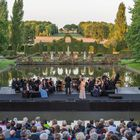 A festival concert, in the gardens.