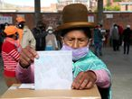 A woman casts her ballot during general elections in La Paz, Bolivia, Sunday, Oct. 18, 2020. (AP Photo/Martin Mejia)