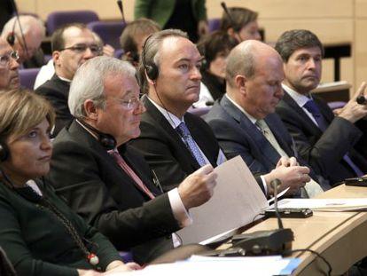 Isabel Bonig, Ramón Luis Valcárcel, Alberto Fabra y Máximo Buch, en el Palacio de Congresos de Valencia.