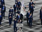 Refugee Olympic Team's flag bearer Yusra Mardini Jorunnardottir and Refugee Olympic Team's flag bearer Tachlowini Gabriyesos lead the delegation during the opening ceremony of the Tokyo 2020 Olympic Games, at the Olympic Stadium, in Tokyo, on July 23, 2021. (Photo by Martin BUREAU / AFP)