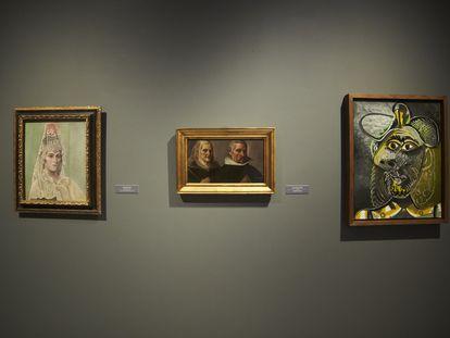 Los cuadros de Picasso, 'Retrato de Olga Kholkhlova con mantilla' y 'Cabeza de Hombre', escoltan a la obra de Francisco Pacheco, 'Retrato de dama y caballero orantes', de la exposición 'Cara a cara: Picasso y los maestros antiguos', del Museo de Bellas Artes de Sevilla.