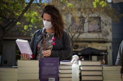A young woman at a book stall in the San Andreu neighborhood of Barcelona.