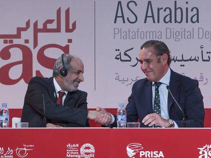 Al Mahmoud y Mirat, en la firma del acuerdo