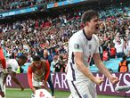 England's Harry Maguire celebrates after Harry Kane scored his side's 2nd goal during the Euro 2020 soccer championship round of 16 match between England and Germany, at Wembley stadium in London, Tuesday, June 29, 2021. (Andy Rain, Pool via AP)
