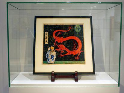 Portada original del tebeo de Tintín 'El loto azul', subastado en París.