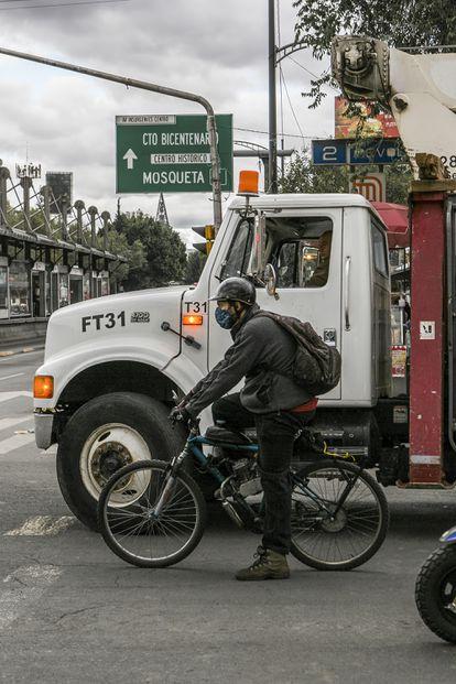 A man rides a bicycle in the Buenavista neighborhood of Mexico City.
