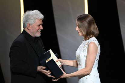 Jodie Foster receives the Palme d'Or of Honor from Pedro Almodóvar during the opening ceremony of the 74th Cannes film festival.