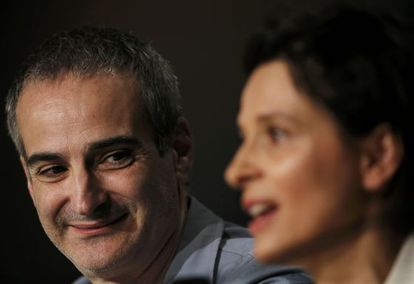 Olivier Assayas y Juliette Binoche en Cannes.