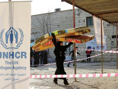 Una refugiada siria en la sede de ACNUR en el norte de Líbano en 2015.