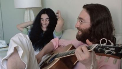 Yoko Ono and John Lennon in an image from the video of the May 15, 1969 performance.