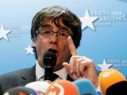 Sacked Catalan leader Carles Puigdemont attends a news conference at the Press Club Brussels Europe in Brussels,