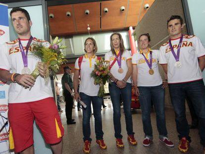 Los medallistas gallegos a su llegada al aeropuerto de Peinador.