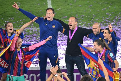 Lluís Cortés and the players celebrate the first Champions of Barcelona.