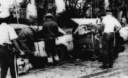 Firefighters investigate the remains of the car in which Orlando Letelier and his assistant Ronni Karpen Moffit were killed in Washington.