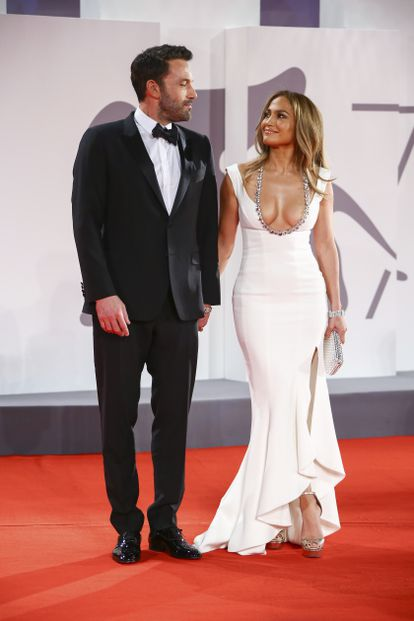 Jennifer Lopez and Ben Affleck pose at the Venice Film Festival.  (Photo by Joel C Ryan / Invision / AP) *** Local Caption ***.