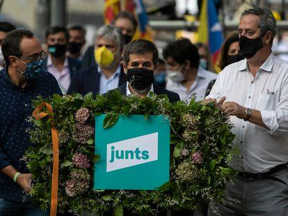 Desde la izquierda, Josep Rull, Jordi Sànchez y Joaquim Forn, en la ofrenda floral ante la estatua de Casanova el 11 de septiembre.