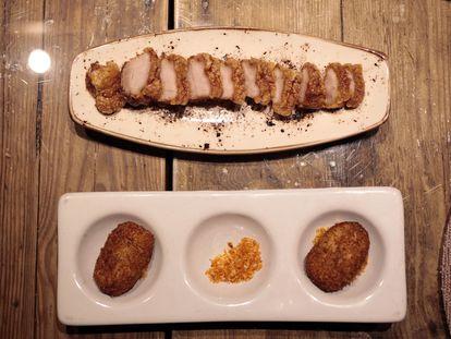 Torreznos y croquetas de cecina con migas del restaurante Ferretería de Madrid.