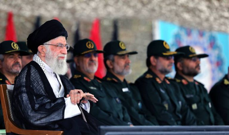 Iran's supreme guide Ayatollah Ali Khamenei, along with officers from the Revolutionary Guard, during a ceremony last year.