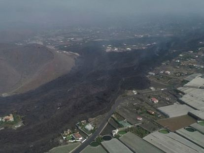 An aerial view of a lava trail surrounding the Cumbre Vieja volcano, as it made its way to the ocean, in this screen grab taken from drone footage, on the island of La Palma, Spain October 1, 2021. Picture taken October 1, 2021. REUTERS TV/via REUTERS