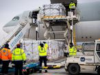 FILE PHOTO: Workers unload a shipment of Chinese company Sinopharm's coronavirus disease (COVID-19) vaccine as it arrives at Budapest Airport, Hungary, February 16, 2021. Ministry of Foreign Affairs and Trade (KKM)/Handout via REUTERS   THIS IMAGE HAS BEEN SUPPLIED BY A THIRD PARTY./File Photo