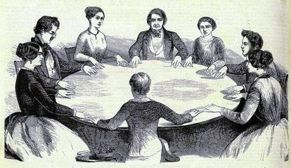 """Engraving of a """"talking table"""" in a spiritualistic ritual of the French weekly 'L'Illustration', published in May 1853 and preserved in the Bibliothèque Nationale et Universitaire de Strasbourg."""