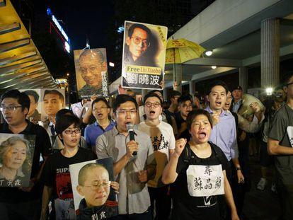 Protesta contra la visita del presidente chino Xi Jinping a Hong Kong y en apoyo del disidente Liu Xiaobo.