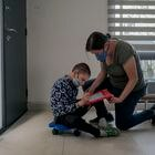 Patricio De Loza (12) performs some math exercises with the help of his mother, Marie Velázquez (41), at her home in the municipality of Metepec, in the State of Mexico on March 10, 2021. Fred Ramos