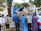 COVID-19 vaccines arrive to be destroyed, in Lilongwe, Malawi, Wednesday, May 19, 2021. Malawi has burned nearly 20,000 doses of AstraZeneca vaccines because they had expired. The government incinerated over 19,000 doses of the vaccine at Kamuzu Central Hospital in the capital Lilongwe. According to Health Secretary Charles Mwansambo the vaccines were the remainder of 102,000 doses that arrived in Malawi on March 26 with just 18 days until they expired on April 13. (AP Photo/Jacob Nankhonya)