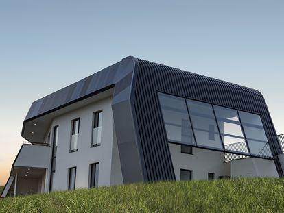 Esta curiosa casa con paredes blancas y fachada negra, que asemeja una nave espacial incrustada en el césped, se encuentra en una parcela a las afueras de Oviedo (Asturias).