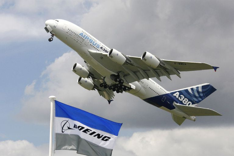 An Airbus A380 flies over the Boeing exhibition area at the Le Bourget air show (Paris).