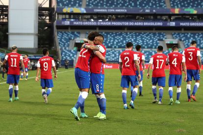 Benjamin Brereton hugs Arturo Vidal, in the match between Chile and Bolivia, in the Copa América.