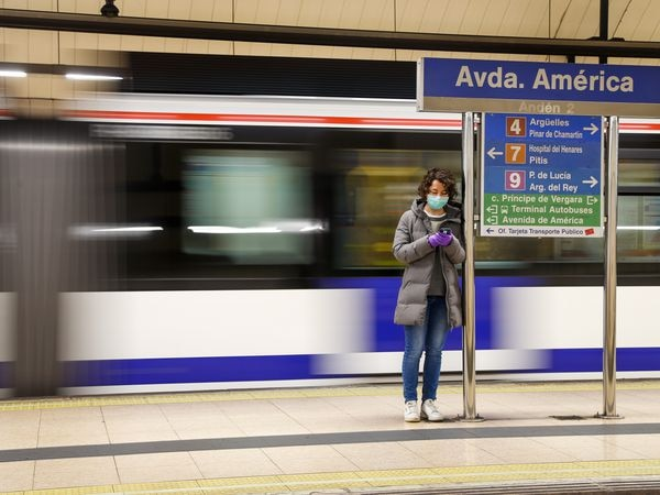 Passengers at the Avenida de America metro station during the confinement amid the outbreak of coronavirus disease (COVID-19) in Madrid, Spain, April 13, 2020.