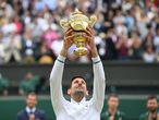 Wimbledon (United Kingdom), 11/07/2021.- Novak Djokovic of Serbia poses for a photo with the trophy after winning the men's final against Matteo Berrettini of Italy at the Wimbledon Championships, Wimbledon, Britain 11 July 2021. (Tenis, Italia, Reino Unido) EFE/EPA/NEIL HALL EDITORIAL USE ONLY