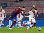 Soccer Football - Champions League - Round of 16 First Leg - FC Barcelona v Paris St Germain - Camp Nou, Barcelona, Spain - February 16, 2021  Paris St Germain's Kylian Mbappe in action with Barcelona's Gerard Pique REUTERS/Albert Gea     TPX IMAGES OF THE DAY