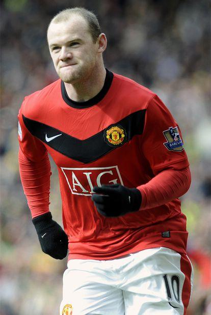 Wayne Rooney celebra su tanto ante el Liverpool.