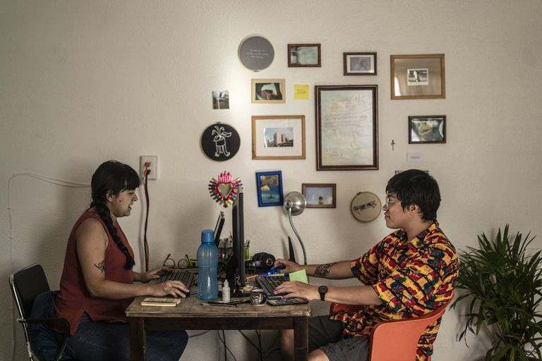 Martha and Emiliano work in their department in Mexico City during the pandemic.