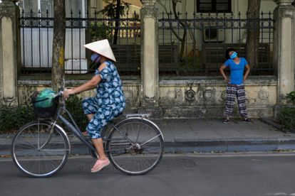 Women with masks in Hanoi, capital of Vietnam, on May 31.