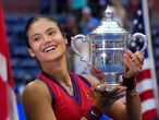 Britain's Emma Raducanu celebrates with the trophy after winning the 2021 US Open Tennis tournament women's final match against Canada's Leylah Fernandez at the USTA Billie Jean King National Tennis Center in New York, on September 11, 2021. (Photo by TIMOTHY A. CLARY / AFP)