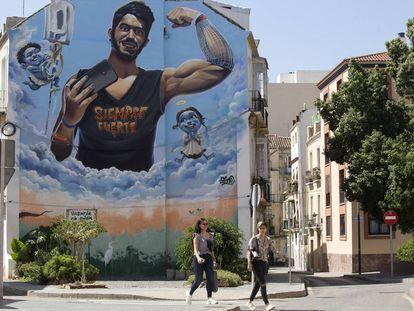 Mural en recuerdo de Pablo Ráez en una calle de Málaga.