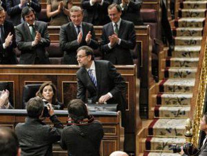 La bancada popular aplaude a Rajoy en el debate sobre el estado de la nación.